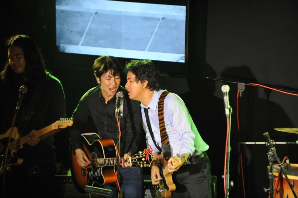 Sharing a mic on Can't Buy Me Love